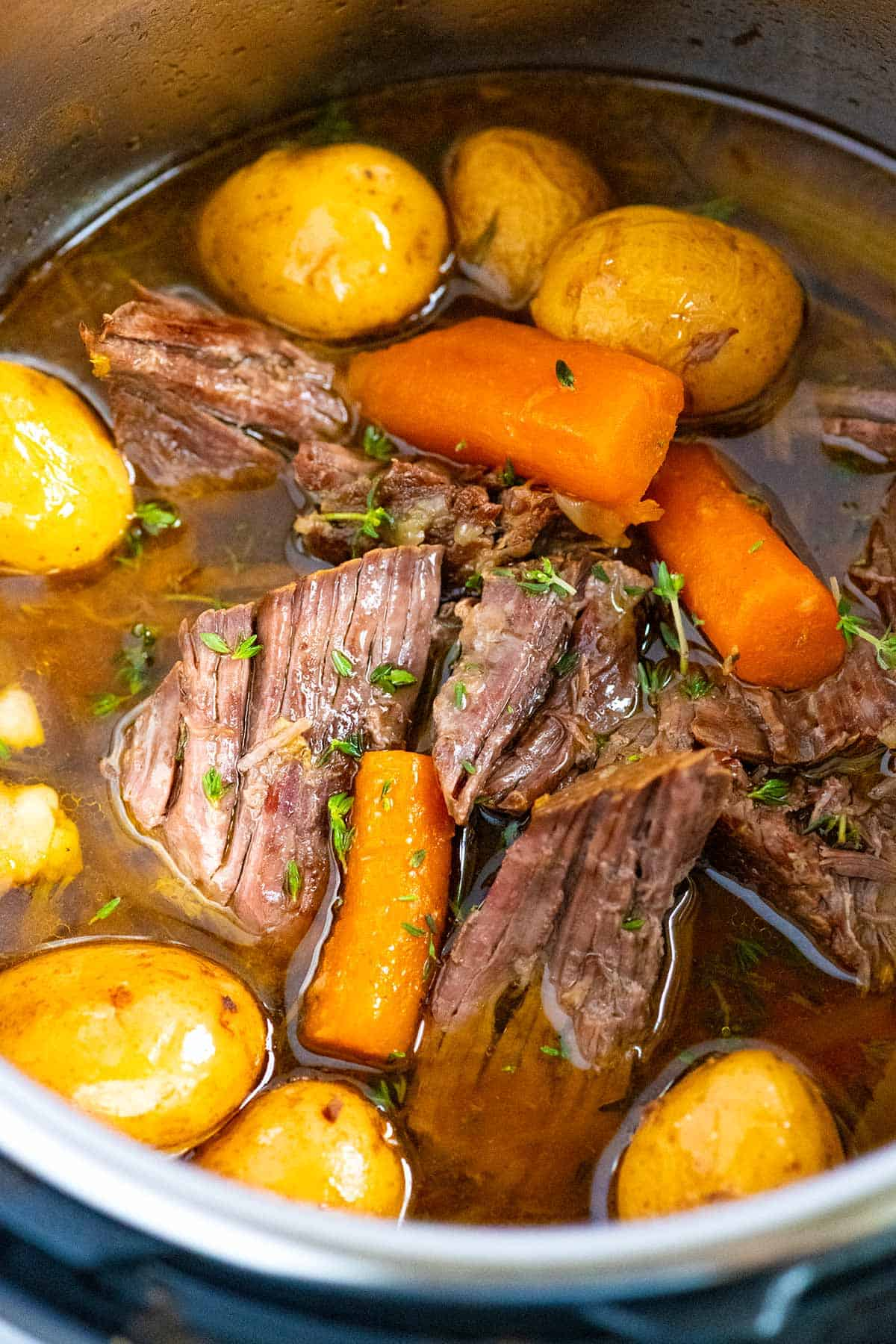 How to make melt-in-your-mouth pot roast using a pressure cooker like an Instant Pot. This easy recipe makes ultra-flavorful beef guaranteed to satisfy the entire family.