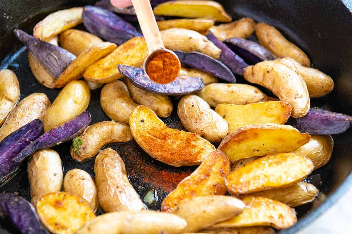 Roasted Fingerling Potatoes // When the potatoes are hot out of the oven, toss them with a little vinegar and smoked paprika. You'll be amazing at how much flavor this adds!
