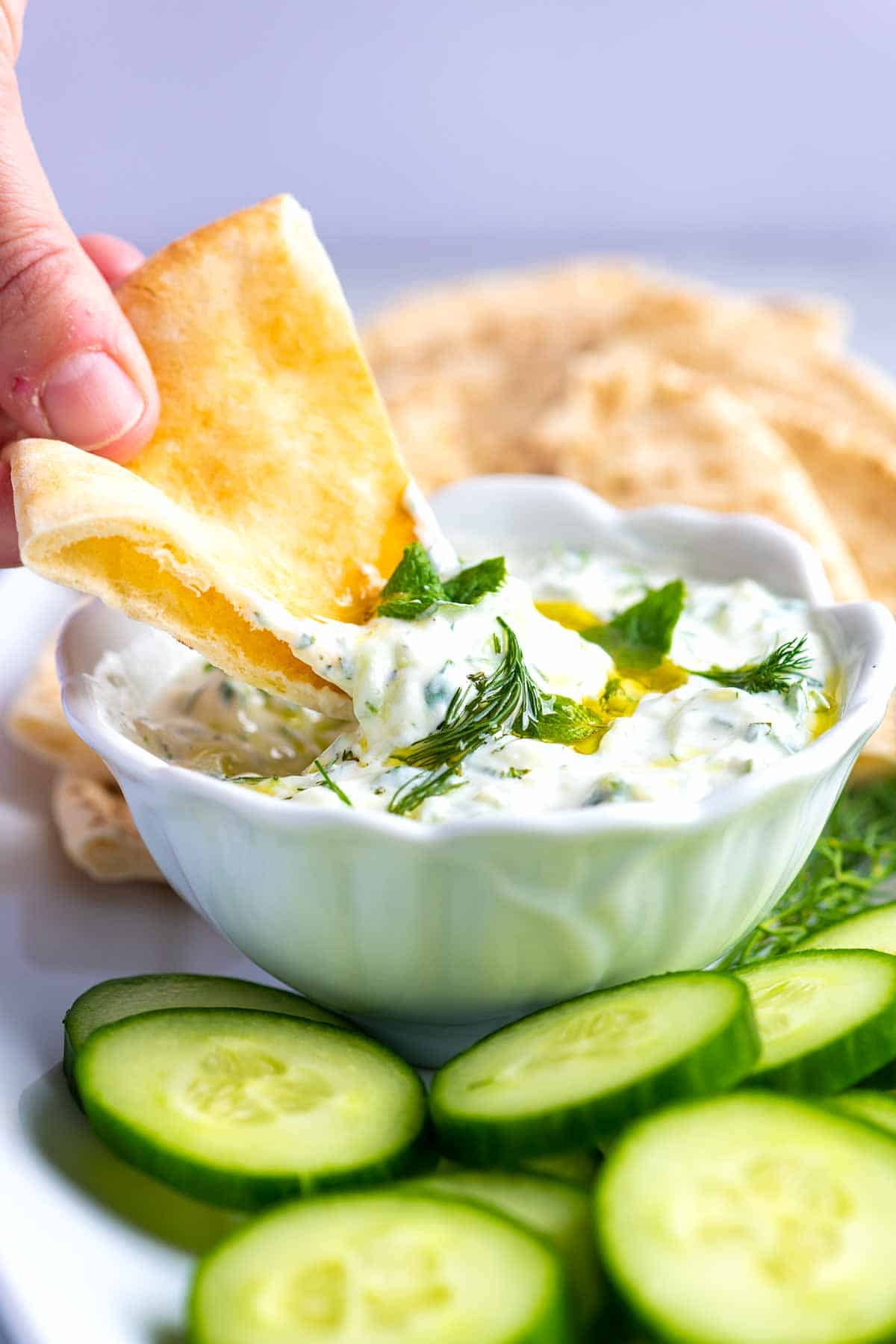 Tzatziki is a creamy, delicious, and simple sauce made with cucumber, yogurt, and fresh herbs.