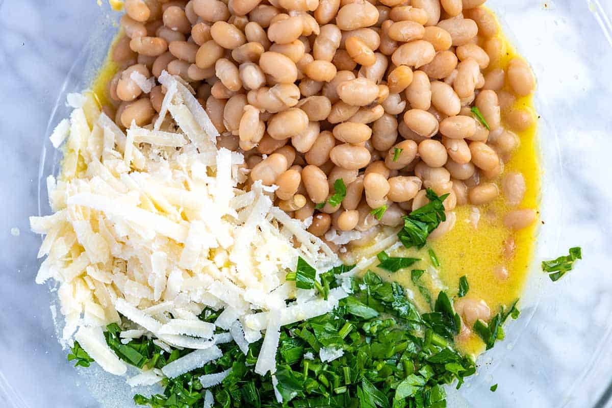 How to make our White Bean Salad -- mixing the ingredients