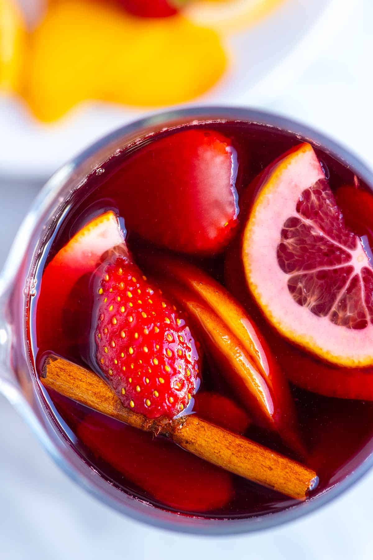 Sangria with Sliced fruit and a cinnamon stick