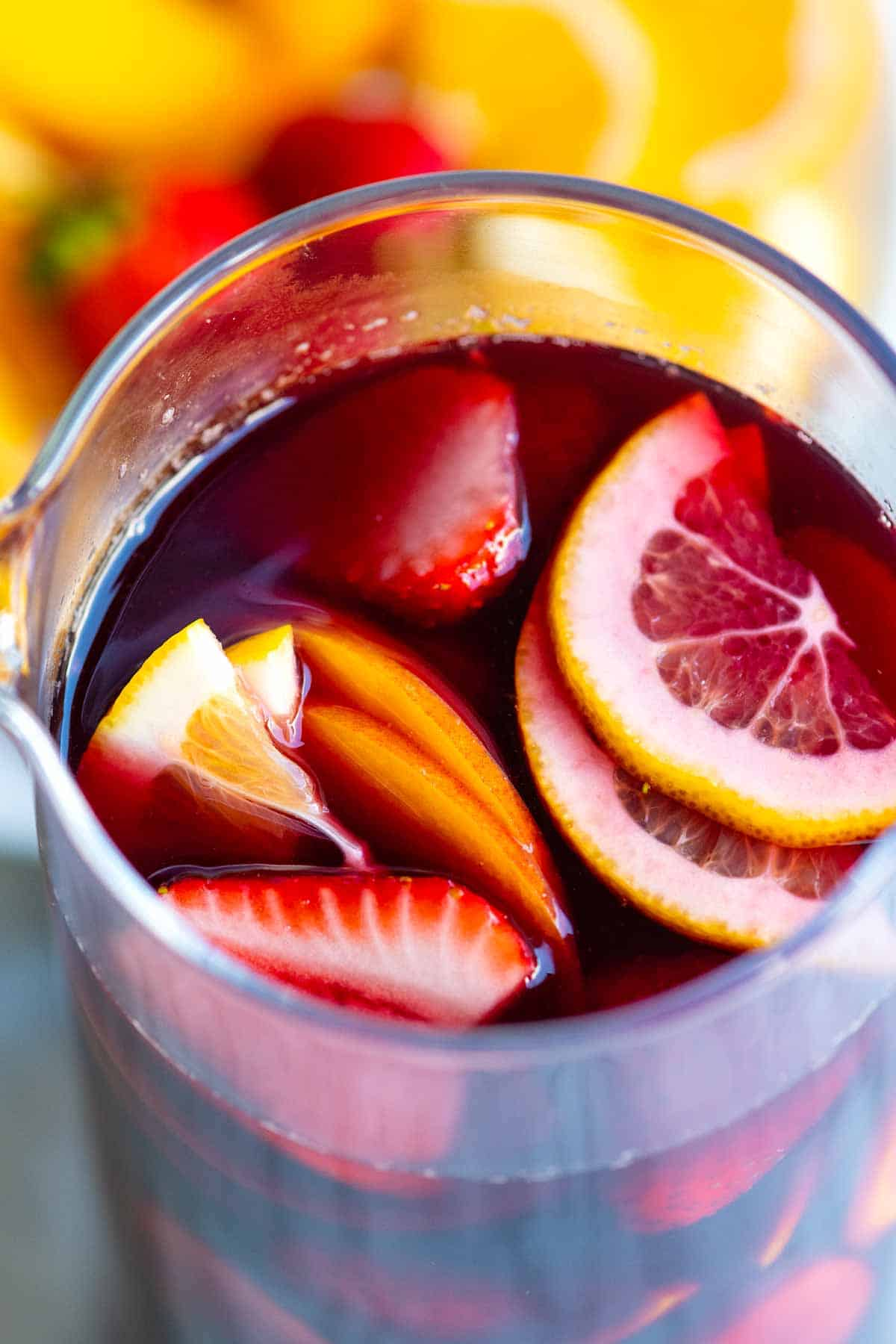 Sangria with fresh sliced oranges, lemon and strawberries