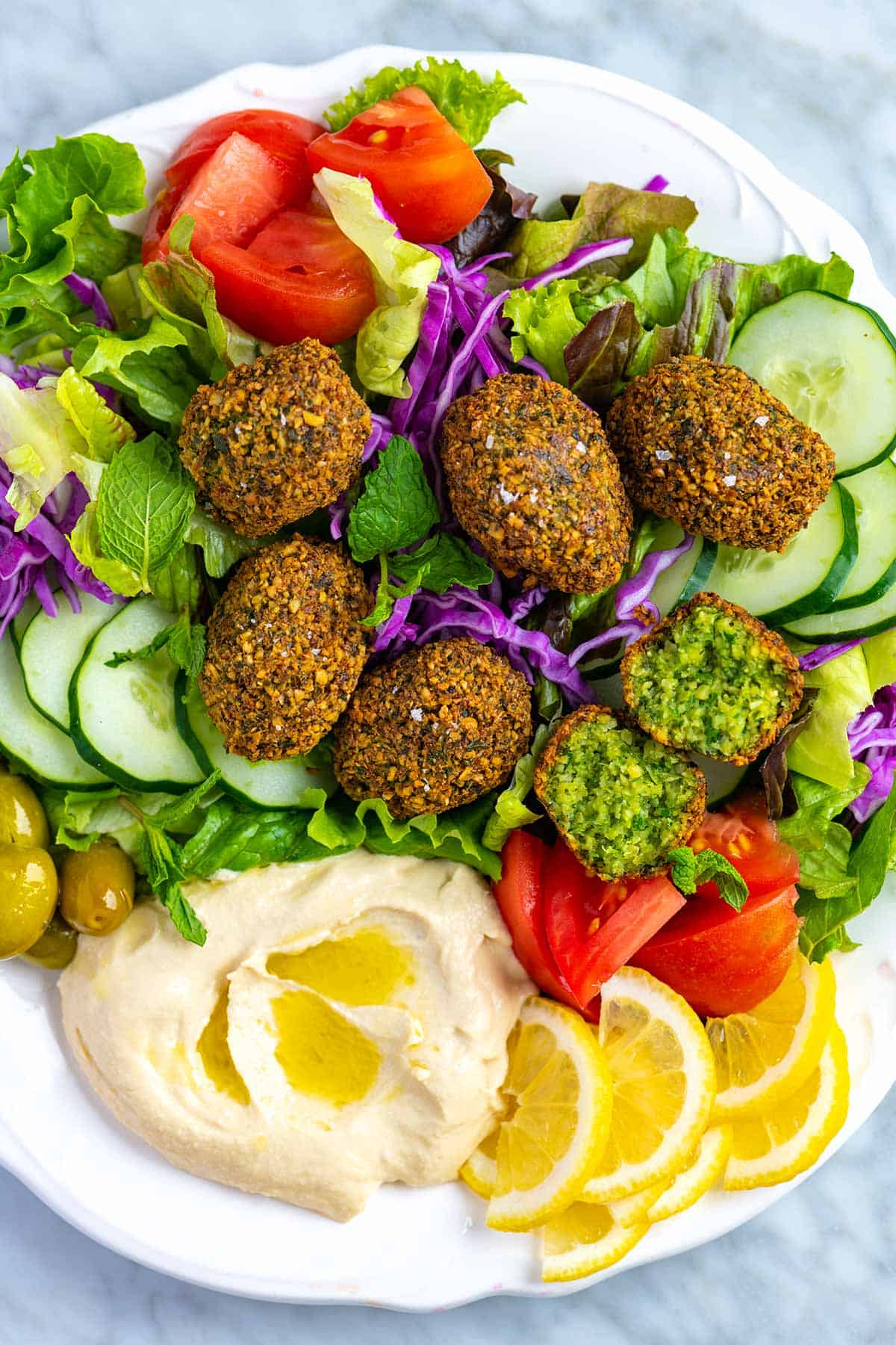 How to make delicious and crispy falafel at home rivaling your favorite restaurants. After lots of kitchen tests, this falafel recipe has become our favorite way to make falafel. The recipe is straightforward, 100% plant-based (vegan), and the falafel taste incredible.