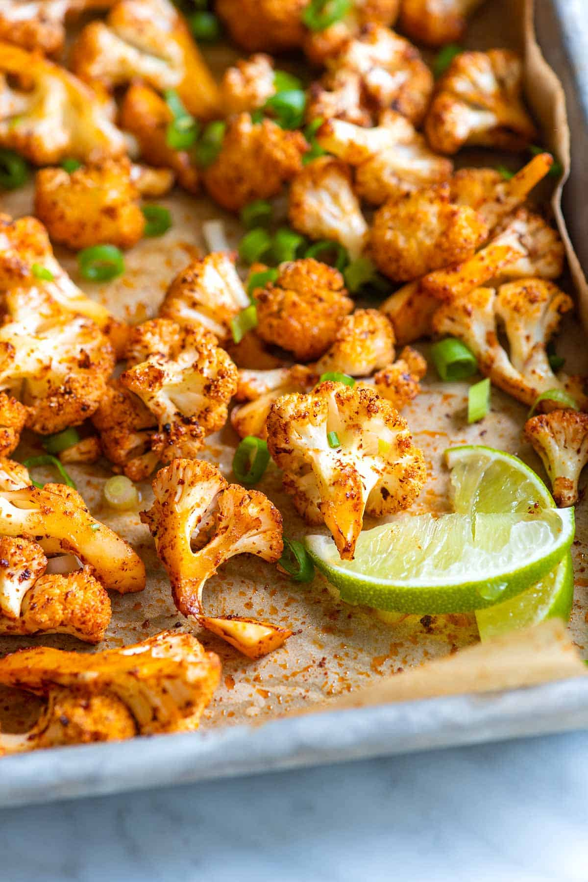 Our chili lime roasted cauliflower recipe combines perfectly roasted and browned cauliflower, ultra-flavorful spices, and fresh lime juice for an almost addictive cauliflower recipe!