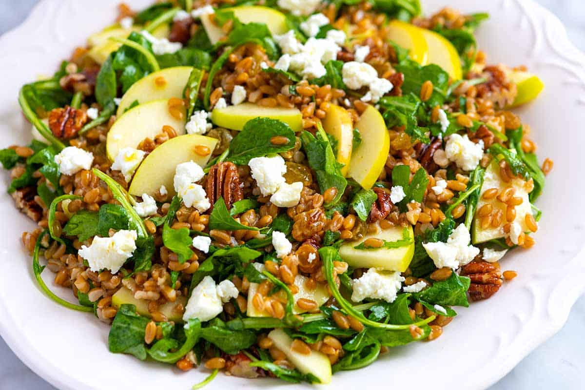 We've fallen in love with this delicious farro salad made with cooked farro, sweet apples, greens, and a bright salad dressing.