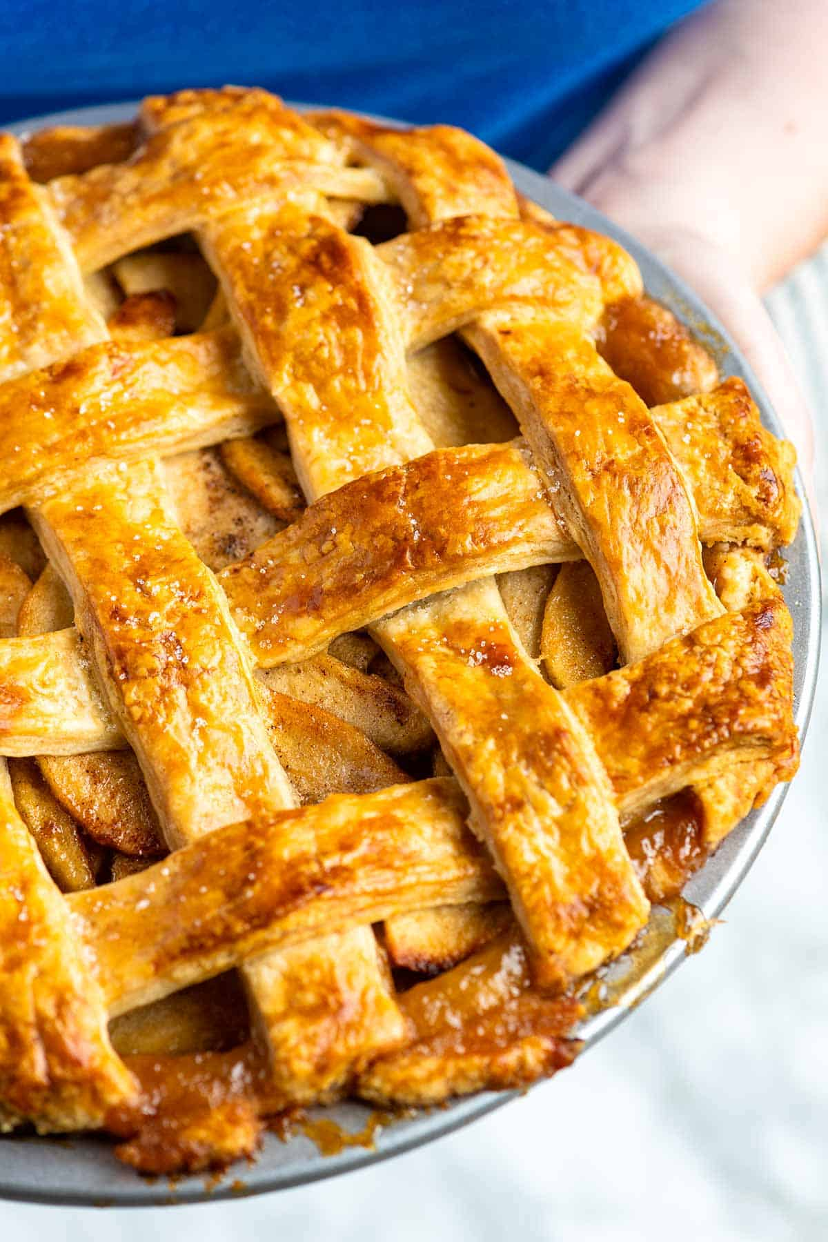 Our favorite recipe for making classic apple pie from scratch. This recipe guarantees apple pie with perfectly cooked (not mushy) apples surrounded by a thickened and gently spiced sauce all baked inside a flaky, golden brown crust.