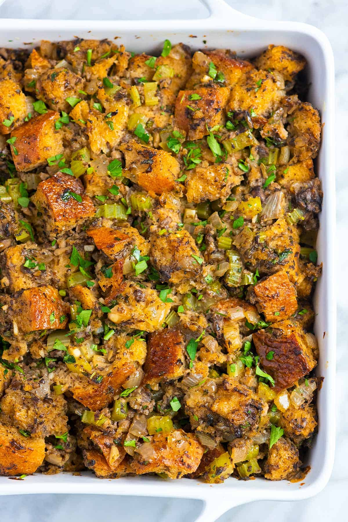 Loaded with fresh mushrooms, onions, sage, and thyme this homemade mushroom stuffing is deeply flavorful and absolutely delicious. The stuffing is savory and soft in the middle, and perfectly crisp on top. It is naturally vegan and you can make it in advance.