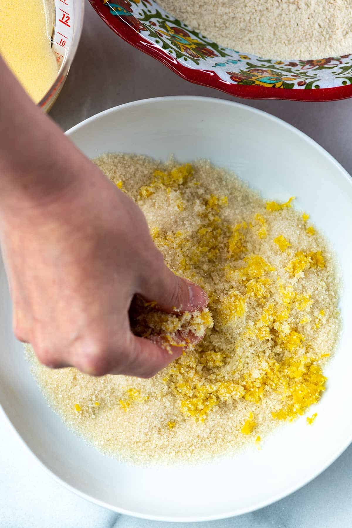 Making lemon sugar for the muffins by rubbing lemon zest into the sugar