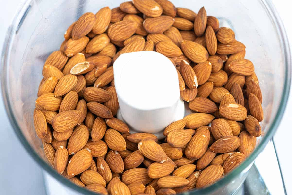 Whole toasted almonds in a food processor