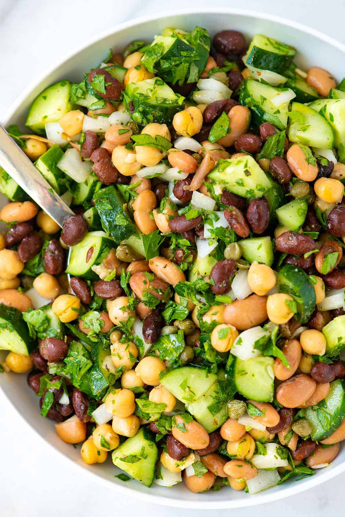 Salad with beans, cucumbers, onion, and parsley