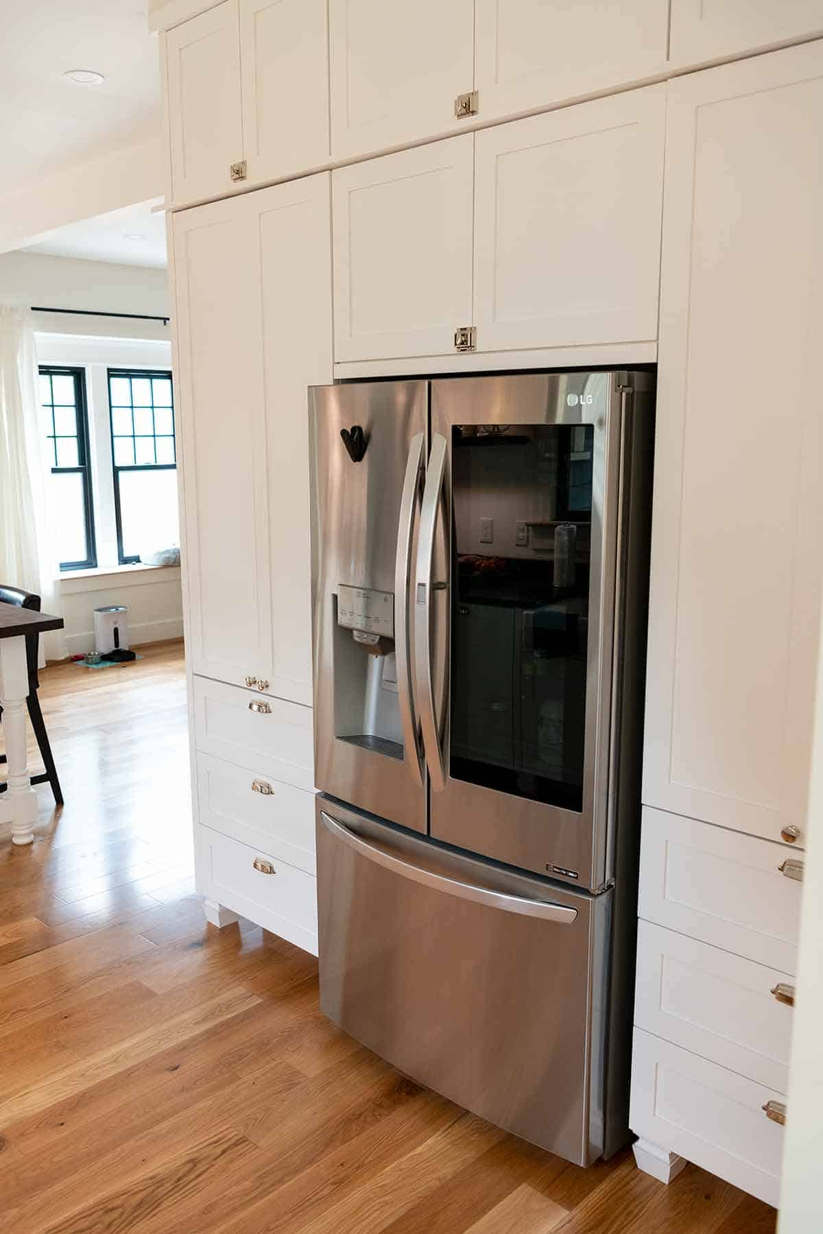 Remodeled kitchen with floor to ceiling cabinets