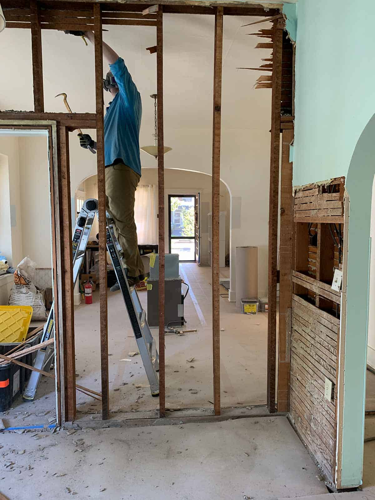 Demoing a wall in the kitchen