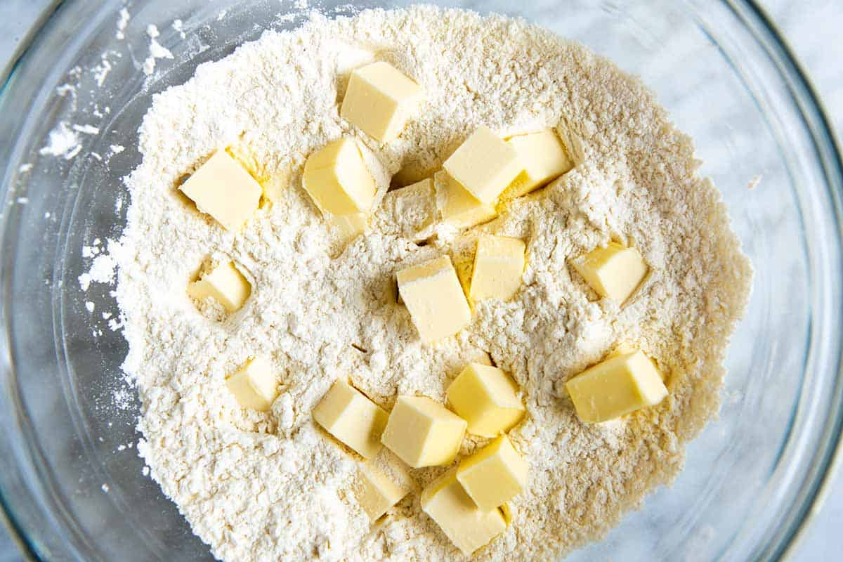 How to make drop biscuits step 1 - adding cold butter to flour