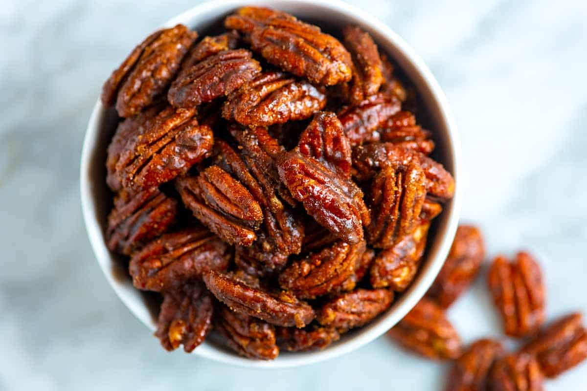 A bowl of candied pecans.
