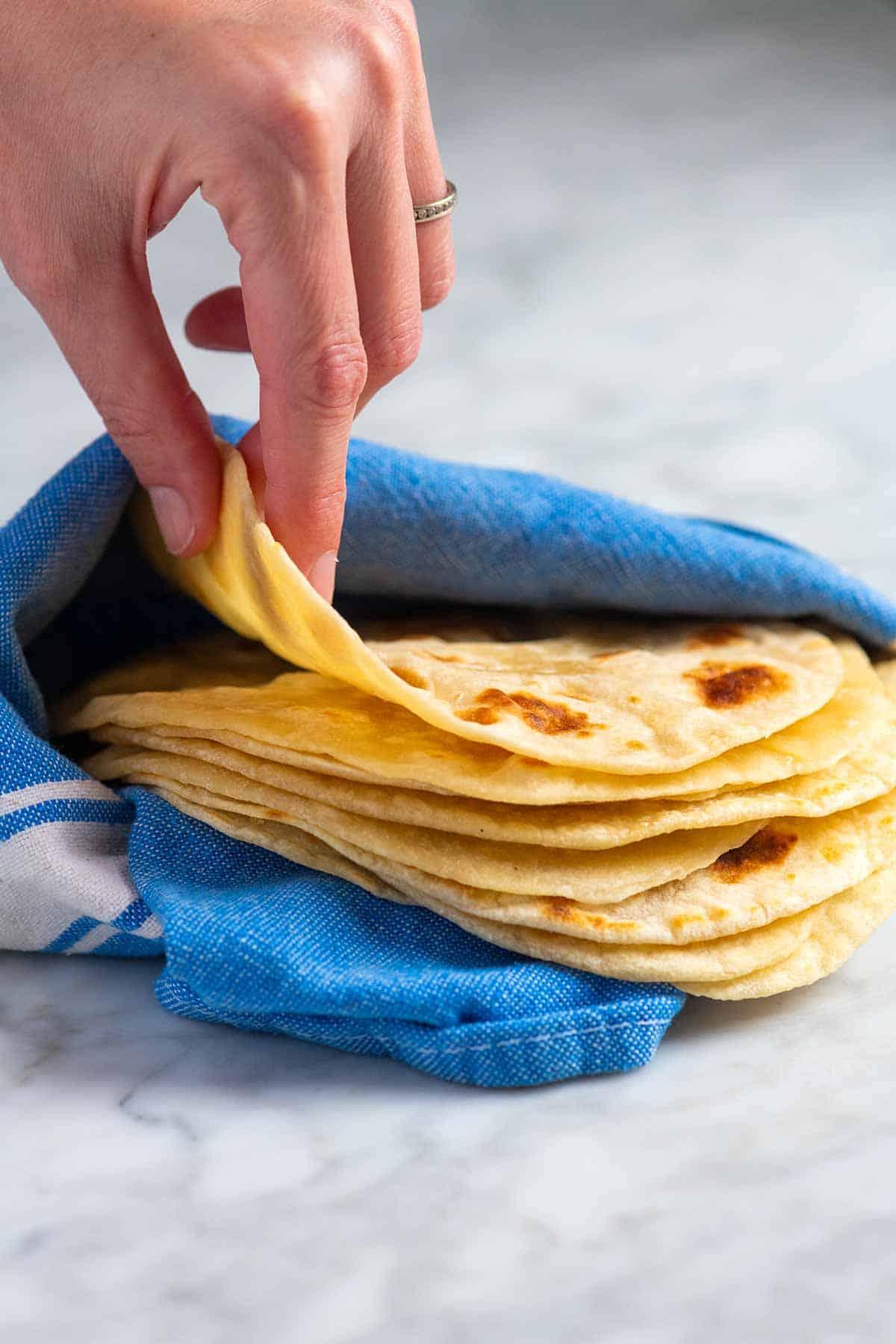 A stack of homemade flour tortillas