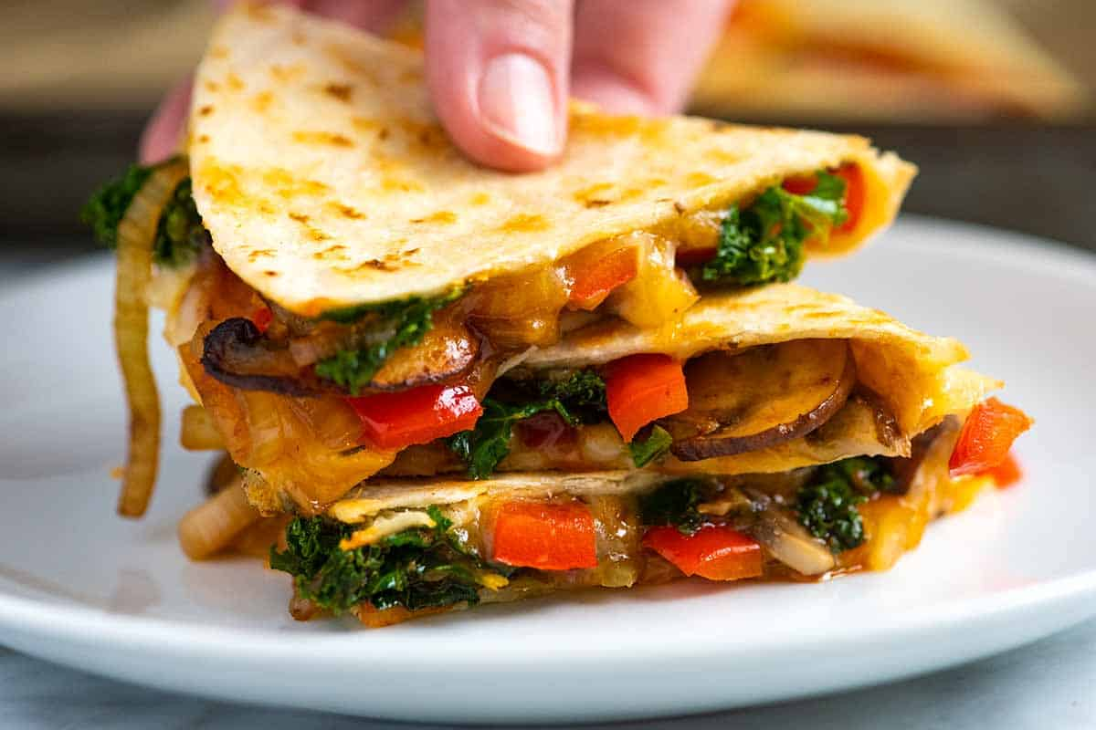 Quesadillas with melted cheese and spiced vegetables