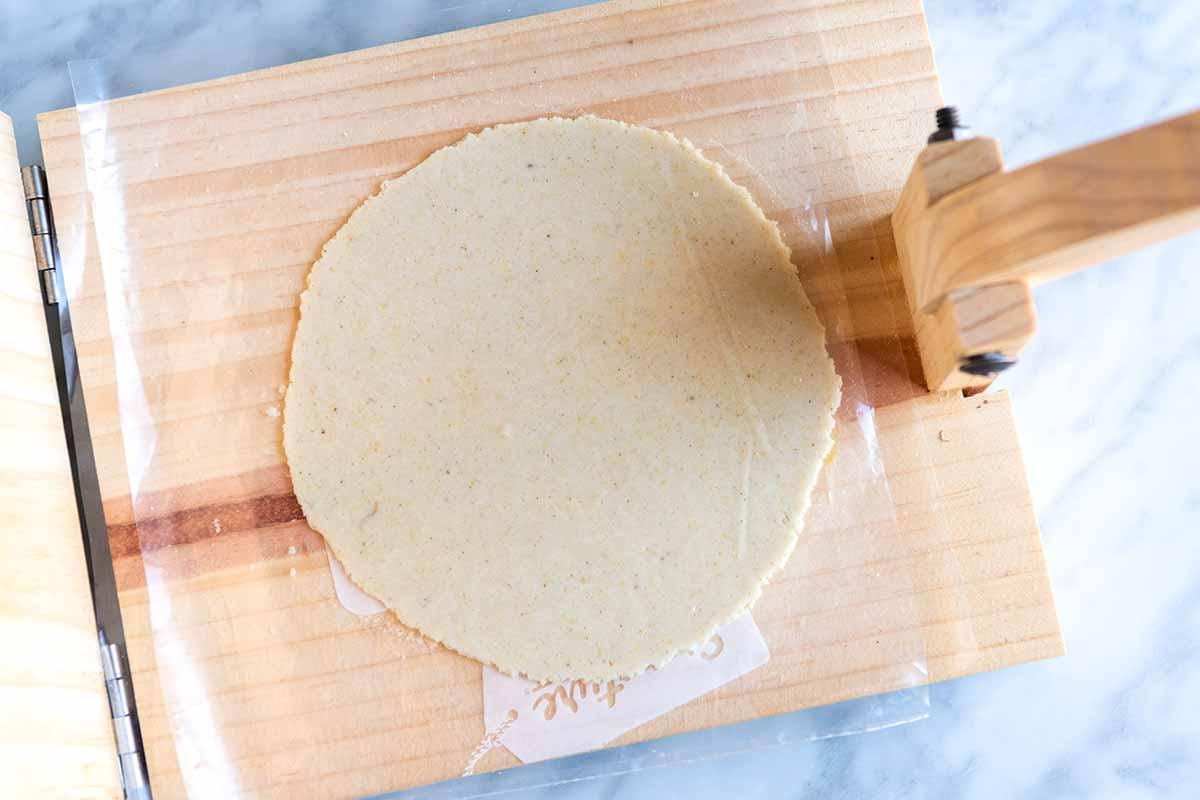 Pressing tortillas using a tortilla press, step 3 (open press).
