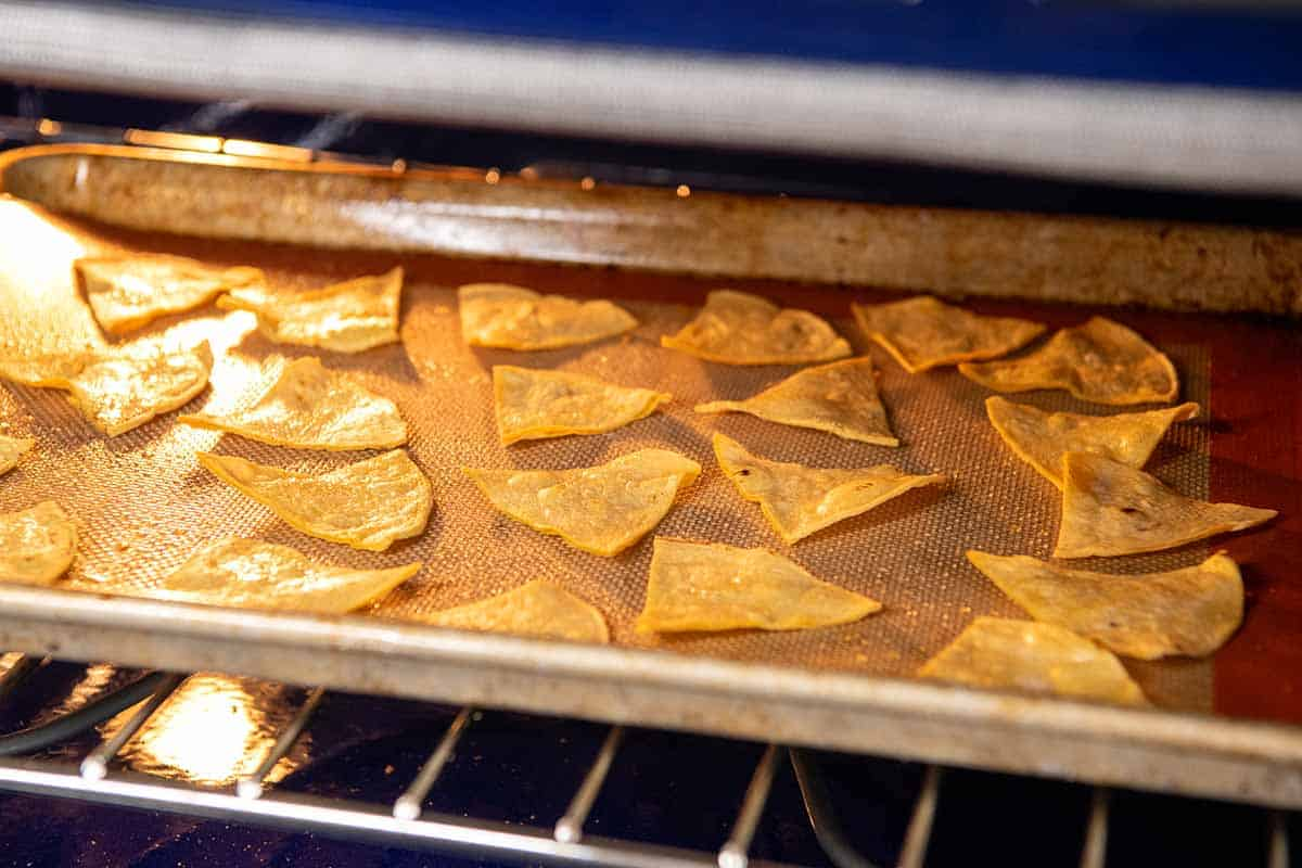 Tortilla chips baking in the oven.