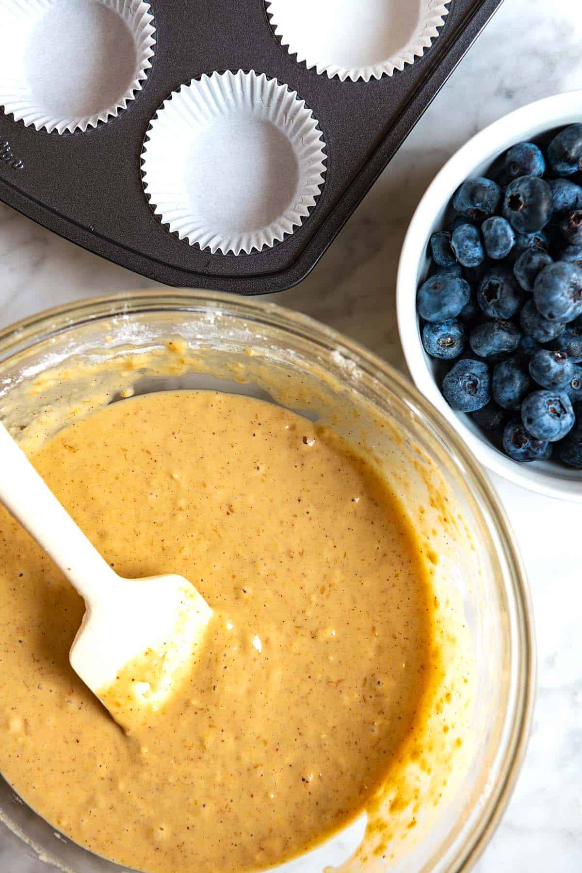 Making vegan blueberry muffin batter